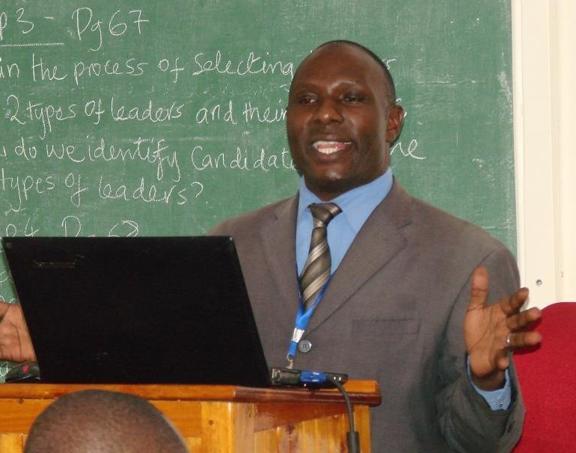 Dr. Julius Madaga